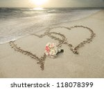 Two Hearts Drawn In Sand At Th...
