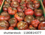 big red tomatoes in the market | Shutterstock . vector #1180814377