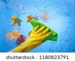 hand in yellow rubber glove... | Shutterstock . vector #1180823791