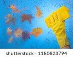 hand in yellow rubber glove... | Shutterstock . vector #1180823794
