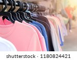 colorful clothes hanging on... | Shutterstock . vector #1180824421