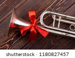 trumpet with red bow. shiny...   Shutterstock . vector #1180827457