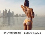 fancy young girl on the beach... | Shutterstock . vector #1180841221