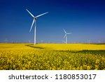wind turbines. fields with... | Shutterstock . vector #1180853017