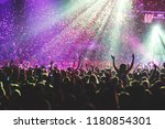 a crowded concert hall with... | Shutterstock . vector #1180854301