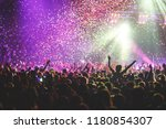 a crowded concert hall with... | Shutterstock . vector #1180854307
