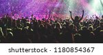 a crowded concert hall with... | Shutterstock . vector #1180854367