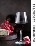 glass of red wine with blue... | Shutterstock . vector #1180867561
