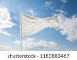white flag against a blue sky... | Shutterstock . vector #1180883467