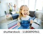 youthful daughter crying and... | Shutterstock . vector #1180890961