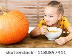 Cute Little Girl Eating Pumpki...