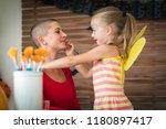 cute little girl applying face... | Shutterstock . vector #1180897417