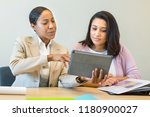 women working together. | Shutterstock . vector #1180900027