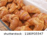 french croissants in the market | Shutterstock . vector #1180935547