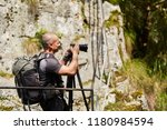 photographer with professional... | Shutterstock . vector #1180984594