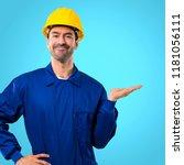 young workman with helmet... | Shutterstock . vector #1181056111