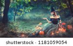 halloween witch with a carved... | Shutterstock . vector #1181059054