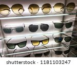 sunglasses in the shop  | Shutterstock . vector #1181103247