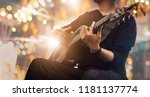 guitarist on stage and sings at ... | Shutterstock . vector #1181137774