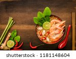 Stock photo thai style noodle in bowl with spoon and chopsticks tom yum kung with thai herbs chilli galangal 1181148604
