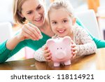 mother and daughter putting... | Shutterstock . vector #118114921