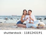 young couple with glasses of... | Shutterstock . vector #1181243191
