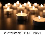 burning candles on table in... | Shutterstock . vector #1181244094
