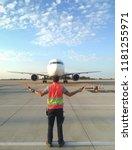 ground crew in the signal vest. ... | Shutterstock . vector #1181255971