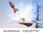 mans hand with tablet pc and... | Shutterstock . vector #1181297767