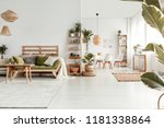 wooden table in front of green...   Shutterstock . vector #1181338864