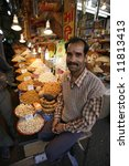 smiling dried fruit vendor in... | Shutterstock . vector #11813413