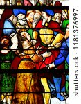 Small photo of Les Andelys, France - march 21 2018 : stained glass window of the collegiate church Notre Dame