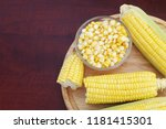 yellow sweet corn on cutting... | Shutterstock . vector #1181415301