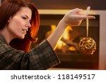 Woman Holding Fancy Bulb...