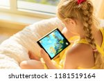 girl playing game on tablet...   Shutterstock . vector #1181519164