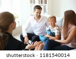 young couple and their son... | Shutterstock . vector #1181540014