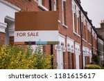 a row of red brick terraced... | Shutterstock . vector #1181615617