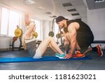 personal trainer assisting... | Shutterstock . vector #1181623021