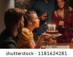 beautiful young woman blowing... | Shutterstock . vector #1181624281