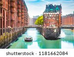 Small photo of Classic view of famous Hamburg Speicherstadt warehouse district with sightseeing tour boat on a sunny day in summer, Hamburg, Germany