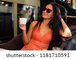 brunette woman in sunglasses... | Shutterstock . vector #1181710591
