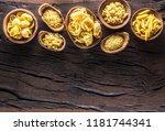 different pasta types in wooden ... | Shutterstock . vector #1181744341