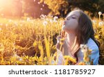 girl blowing seeds from a... | Shutterstock . vector #1181785927