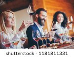 a group of sommeliers tasting... | Shutterstock . vector #1181811331