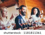 a group of sommeliers tasting... | Shutterstock . vector #1181811361