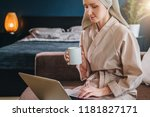 young woman in bathrobe and... | Shutterstock . vector #1181827171