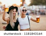 two female friends drinking... | Shutterstock . vector #1181843164