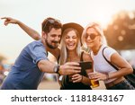 group of friends drinking beer... | Shutterstock . vector #1181843167