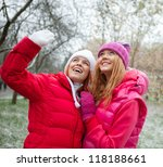 Two Girls In The Snow Covered...