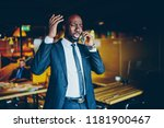 stressed african american male... | Shutterstock . vector #1181900467